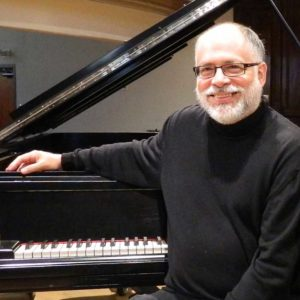 Robert Holliston with the VCM's Steinway Grand Piano